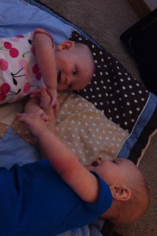 Playing with his sister
